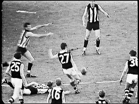 The iconic moment. Barry Breen unloads the winning point.